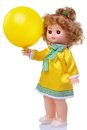 Vintage doll in yellow dress with baloon Royalty Free Stock Photo