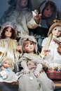 Vintage dolls porcelain in classical robes in the window of an antique shop Royalty Free Stock Images