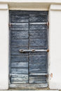 A vintage door with metal hinges Royalty Free Stock Photo