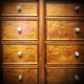 Vintage dresser wooden chest of drawers with metal handles Stock Image