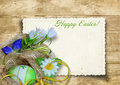 Vintage Easter card with nest of easter egg on a wooden backgrou Stock Photography