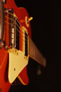 Vintage electric blues guitar closeup on black background. Selective focus. Royalty Free Stock Photo