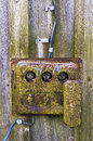Vintage electric box retro distributive a rust a moss and a mold on metal and wooden boards Royalty Free Stock Images
