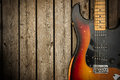 Vintage electric guitar background a beat up dirty and road worn old body against a natural wood grain boards Royalty Free Stock Photography