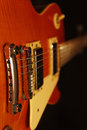 Vintage electric rock guitar closeup on black background. Selective focus. Royalty Free Stock Photo