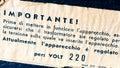 Vintage electroshock warning label on  vintage radio in Italian Royalty Free Stock Photo