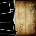Vintage empty photo-frames on wood. Royalty Free Stock Photo