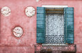 Vintage facade with decorative window lace curtains and shutters on ancient pink Stock Photography