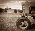 Vintage Farm Landscape with Tractor and Barn Royalty Free Stock Photo