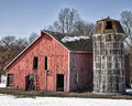 Vintage farmstead landscape image of an old barn with wooden silo springtime in wisconsin Stock Photography