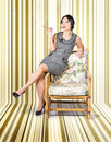 Vintage fashion portrait of elegant smoking woman on chair inside a retro striped interior Stock Photos