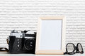 Vintage film camera and blank photo frame Royalty Free Stock Photo