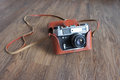 Vintage film camera in leather case Royalty Free Stock Photo