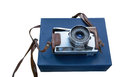 Vintage film photo camera on a blue box Royalty Free Stock Photo