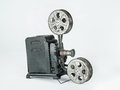 Vintage film projector a retro cine camera on a plain grey background Stock Photo