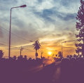 Vintage filtered : silhouette landscape of cars on road,sunset s Royalty Free Stock Photo
