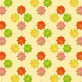 Vintage flower pattern in warm colors on yellow Stock Photos