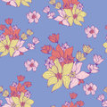 Vintage flowers seamless background pattern of arrangements of beautiful in muted pastel shades scattered on a soft blue Royalty Free Stock Images