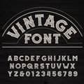 Vintage font. Dirty letters on a grunge wooden background.
