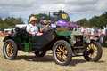 Vintage ford motorcar potten end uk july a exits the show arena having just given a public display at the dacorum steam fair on Stock Image