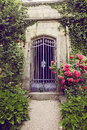 Vintage forged gate garden with an alley leading to the Stock Image