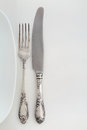 Vintage fork and knife near the plate Royalty Free Stock Photo
