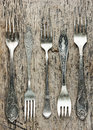 Vintage forks collection on old wooden background