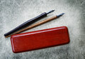Vintage fountain pens, and pencil case Royalty Free Stock Photo