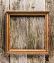 Vintage frame on old wooden background golden Royalty Free Stock Photos