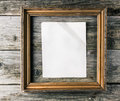 Vintage frame with paper on old wooden background golden witn crumpled blank Royalty Free Stock Photos