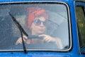 Vintage girl in car under rain Stock Images