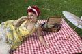 Vintage girl having a picnic Royalty Free Stock Photo