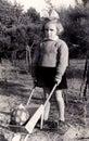 Vintage girl with wheelbarrow Royalty Free Stock Photo