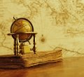 Vintage globe against old map Royalty Free Stock Images