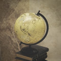 Vintage globe and books with effect Royalty Free Stock Photo