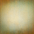 Vintage gold background blue stripes and faded center and old distressed texture Royalty Free Stock Photo