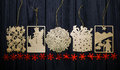 Vintage gold flat Christmas tree toys with red stars on wooden background