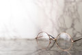 Vintage golden Eyeglasses on luxury marble stone Royalty Free Stock Photo