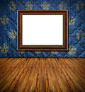 Vintage golden frame on blue stitched textile wall Royalty Free Stock Photo