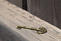 Vintage golden key on beam of barn Royalty Free Stock Image