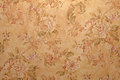 Vintage golden run down victorian wallpaper with baroque floral pattern Royalty Free Stock Photo