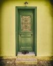 Vintage green wooden door on yellow house door Royalty Free Stock Photo