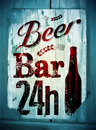 Vintage grunge style beer bar poster. Retro typographical vector illustration on wood background. Eps 10. Royalty Free Stock Photo