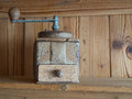 Vintage hand cranck coffee grinder, wooden boards background Royalty Free Stock Photo