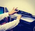 Vintage hand with working copier open cover copy printer Royalty Free Stock Photography