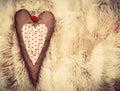 Vintage handmade plush heart pillow on soft blanket