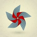 Vintage handmade red and blue pinwheel with dots Royalty Free Stock Photo