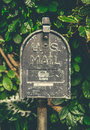 Vintage hawaiian us mail box retro style post against lush tropical background in hawaii Stock Images