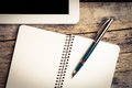 Vintage image of digital pad and old fountain pen with notebook Royalty Free Stock Photo