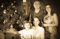 Vintage image of happy family near christmas tree three generations at home Royalty Free Stock Images